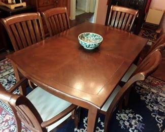 Dining table and 6 chairs. Antique Chinese bowl for sale separately.