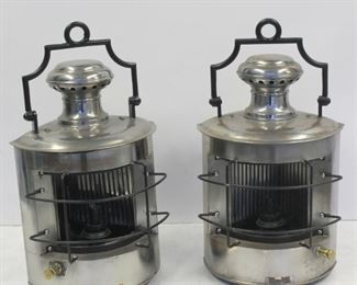 A Pair Of Polished Metal Ships Lanterns