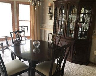Dining Table with 6 chairs and china hutch - lit