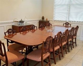 Antique Banded Mahogany Hepplewhite dining table - extends to 10 ft (as pictured) with leafs.  12 Shield back dining chairs