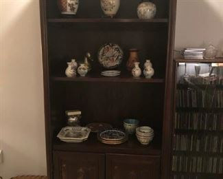 Wall unit with applied oriental motiff
