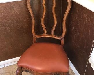 10 dining room chairs.  8 Leather and 2 plaids