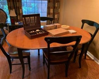 dining table 4 chairs - table collapses to round,  and has two leaves.