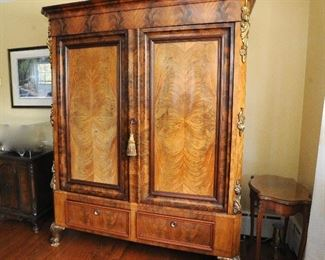 Stunning bookmatched armoire. Breaks down for easy moving and re-assembly, because once upon a time, furniture was made well.
