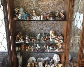 CURIO CABINET WITH LOTS OF COLLECTIBLE CATS AND DOG FIGURINES