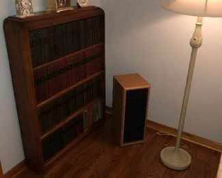 Floor Lamp and Wooden Book Shelf with Assorted Clocks.