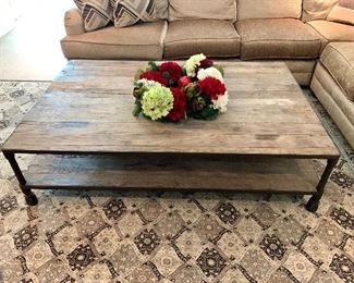 "Rustic Coffee table with reclaimed wood top and bottom shelf. Wrought Iron edges and legs Completes this unique Industrial look.                                           Measures: 67""x431/4""x171/4"""