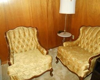 Button tufted antique chairs