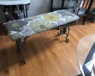 iron bench with newer upholstery