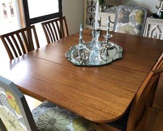 mahogany dining room table with decorative accent chairs. Not original, but go together very nice.