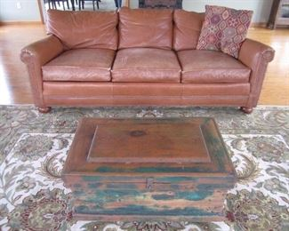 LEATHER SOFA, TRUNK, RUG NOT FOR SALE