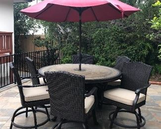 Bar height table chairs and umbrella