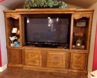 Large Flat Screen Television + Entertainment Center that is very nice!!!