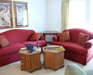 Sofa and loveseat with matching slipcovers.