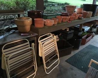 Great wooden garden table and lots of planters and pots