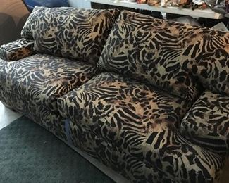 Loveseat with animal print fabric and it's a sleeper!