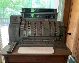 Antique national cash register with oak stand