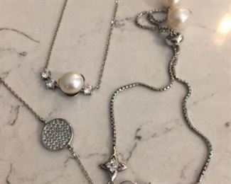 Pearl and CZ bracelet $20 CZ coin bracelet $25