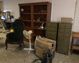 Bookshelves, antique chair, humidifier in box