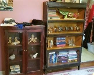 Several cabinets and lawyers bookshelf