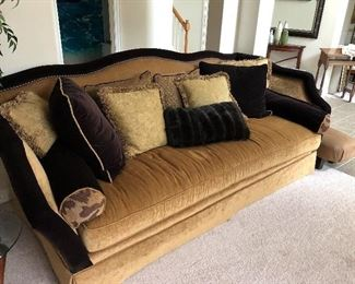 lovely stuffed couch and matching throw pillows