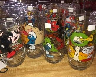 """Smurf"" and Peanuts"" collectible glasses"