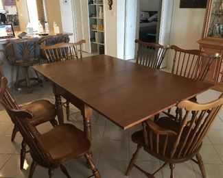 Gorgous all wood dinning room table.  Has 3 leafs for inserts extending table to 8'. Pads are included, and 6 spindle chairs.  Perfect condition