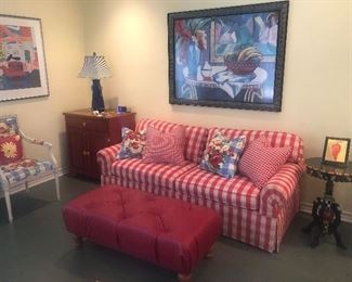 Checkered sofa bed, with ottoman side tables and matching art pieces