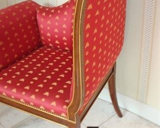 Entry: The curved side of the parlor deaux chair is better seen.   Note the raspberry/gold Napoleonic bee brocade, nail head trim, and gold striping on the mahogany frame.
