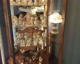 Curio cabinet with an assortment of Precious Moments and a couple of misc pieces.