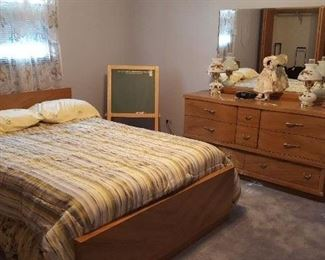 """Vintage """"Harmony House"""" bedroom furniture with antique lamps, luggage and even the chalkboard."""