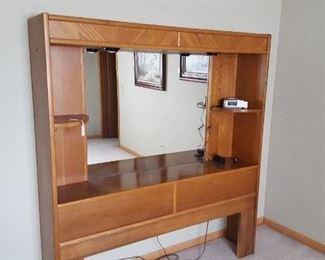 Queensize mirrored oak headboard.