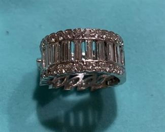 This is the back view of This stunning diamond ring boasts 6.8 carats of diamonds set in platinum.  The band  is size 7. The diamonds are GH color and VS1 clarity. Appraised for just over $18,000 and is offered at $9000.