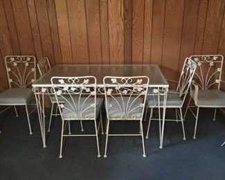 "Wrought Iron Glass Top Table with 6 Chairs - Located in the Basement/Patio •	54""x32"""