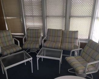 Patio Furniture with Cushions - Located in the Basement/Patio •	White with Soft Pastel Stripe Cushions •	Metal Frames •	1 Glider •	3 Swivel Rocker Chairs •	2 End Tables