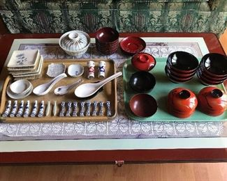 Collection of Japanese rice bowls and soup bowls, chopstick rests and rests.