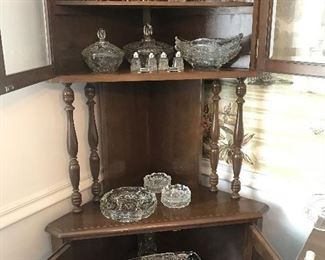 Corner cabinet and glass serving pieces.