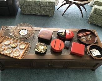 Custom made Japanese coffee table with carvings and glass tabletop.  An assortment of vintage Japanese serving pieces.