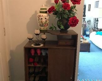 Vintage womens' shoes, Large flower arrangement, ceramic vase and vintage candleholder.