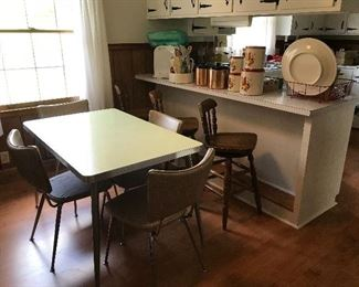 Mid century kitchen table and chairs. Boling wooden swivel counter stools.