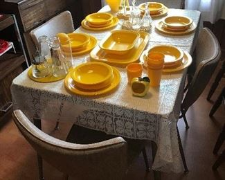 20 piece Texasware yellow melamine dinnerware, along with other yellow kitchen items.