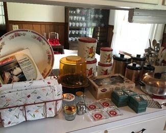 Assorted kitchen items - Mirro cookie press, Revere copper utensil hooks (New), Rubbermaid carrousel (New)
