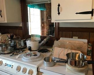 Electric rice cooker, stovetop covers, pots. Cutting boards, spoon rests.