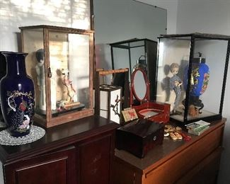 A collection of Japanese dolls, a mini Japanese makeup dresser, a tabletop decorative lamp, a decorative paper lantern (it does not light up), a jewelry box, and a couple of abacus.  A mid century dresser with mirror, along with a full size bed (shown in previous photo).