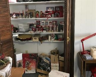 An assortment of Christmas ornaments (i.e. Hallmark, Fitz and Floyd, etc.) decorations, wreaths, serving platters, lights, etc. Some items are new. Lights have been checked and are labeled as working and not working.
