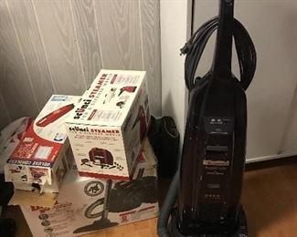 Dirt Devil vacuum and cordless handheld vacuum. Scunci steamer. Kenmore Hepa vacuum.