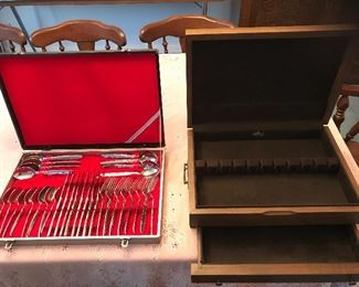 Stainless steel utensil set in case.  Wooden storage box for silverware.