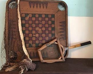 Vintage game table top, tennis racket, and badminton net.