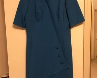This is made of 70s polyester, check out that asymmectrical hem tab