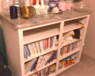 That bookshelf is really old and has a metal top.